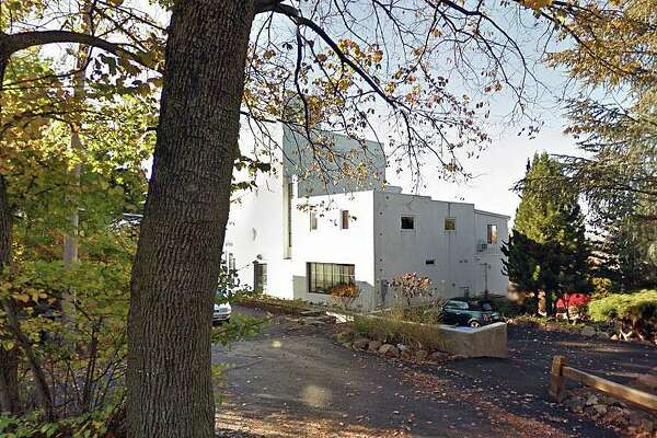 The house at 150 Deepwood Drive in Hamden, Conn., is on the market for almost $2 million.