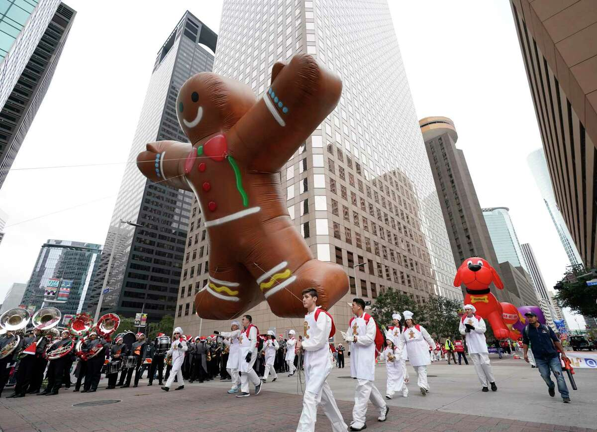 Balloons are carried during the 70th Annual H-E-B Thanksgiving Day Parade downtown Thursday, Nov. 28, 2019, in Houston. The streets of downtown Houston were quiet on Thanksgiving Day 2020 because the annual parade was canceled due to COVID-19.