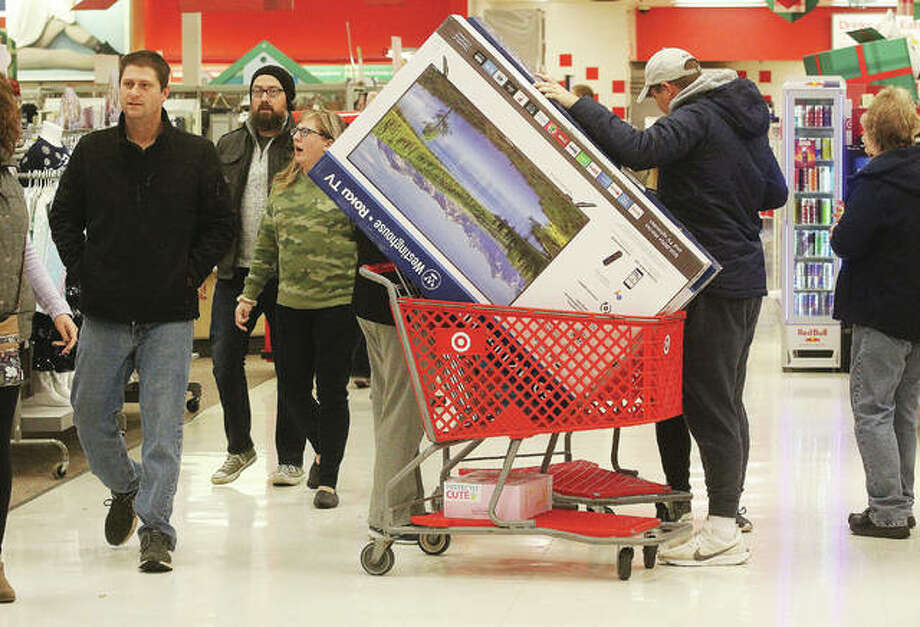 Customers walk one of the main aisles at the Alton Target store last year during the start of the holiday shopping season. Because of COVID-19, this year will be very different, with few stores open on Thursday, month-long sales in an attempt to reduce crowd surges and an emphasis on online sales. Photo: Scott Cousins|The Telegraph