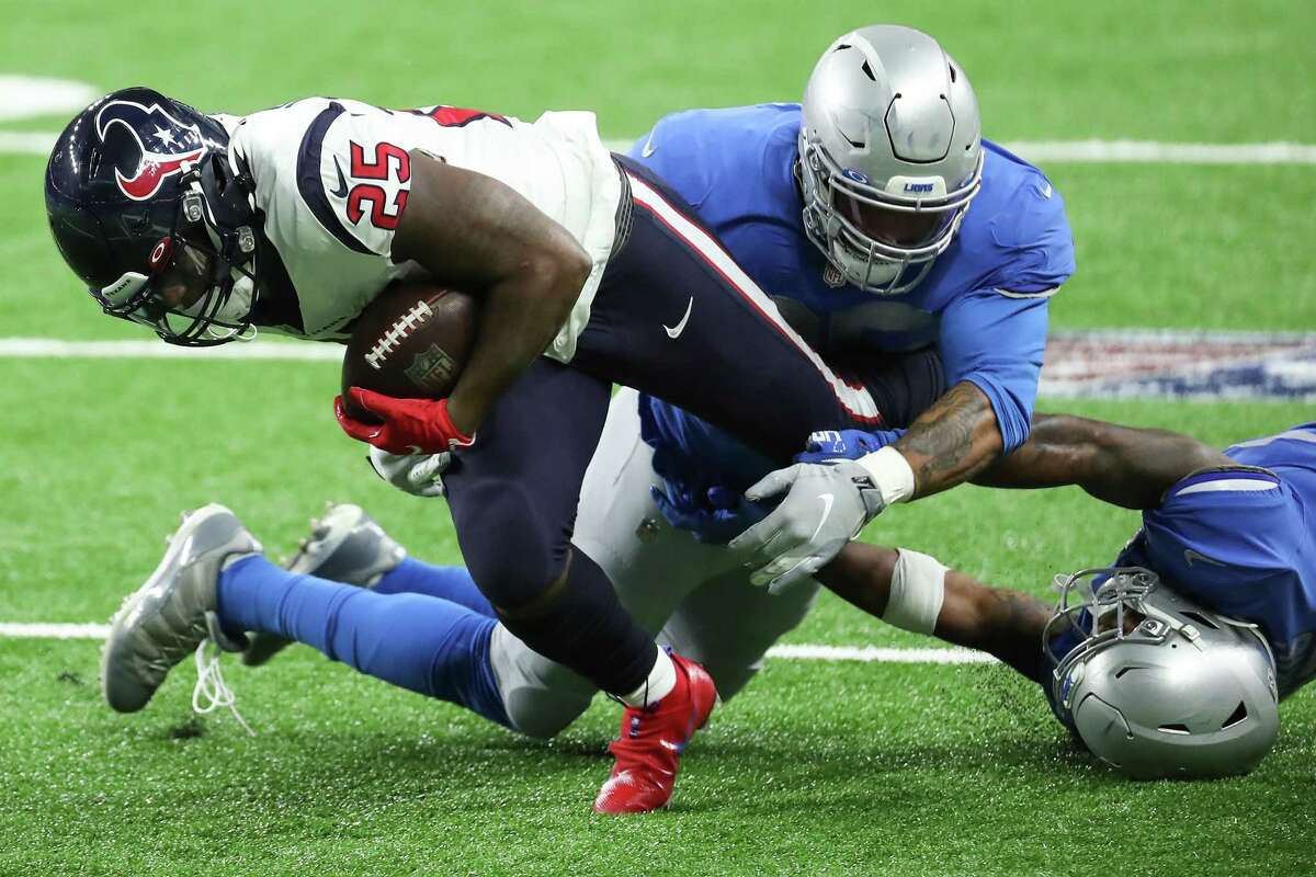 Houston Texans running back Duke Johnson (25) fights for yardage against the Detroit Lions during the first quarter of an NFL football game at Ford Field Thursday, Nov. 26, 2020, in Detroit.