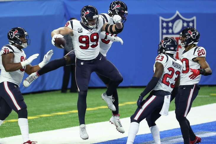 Houston Texans defensive end J.J. Watt (99) celebrates his interception of a pass by Detroit Lions quarterback Matthew Stafford (9) for a touchdown during the first quarter of an NFL football game at Ford Field Thursday, Nov. 26, 2020, in Detroit.