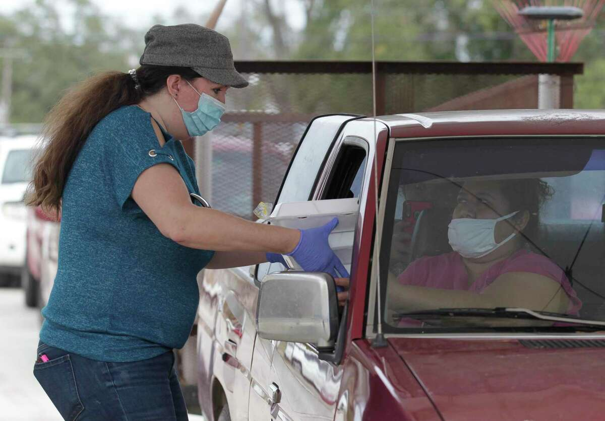 Volunteers helped hand out more than 1,500 meals during the annual Friends Feeding Friends Thanksgiving meal, Thursday, Nov. 26, 2020, in Conroe. Volunteers handed out 1,500 meals to community members.