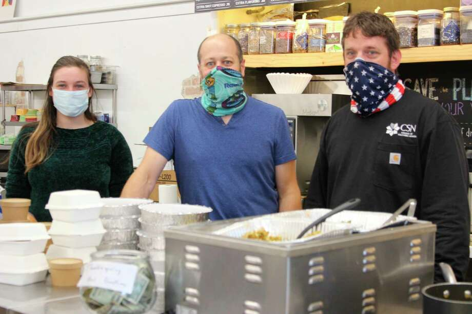 Blaire Lone, Chris Mekas and Jason Mitchell serve up Thanksgiving dinner at petals and Perks. (Photo/Colin Merry)
