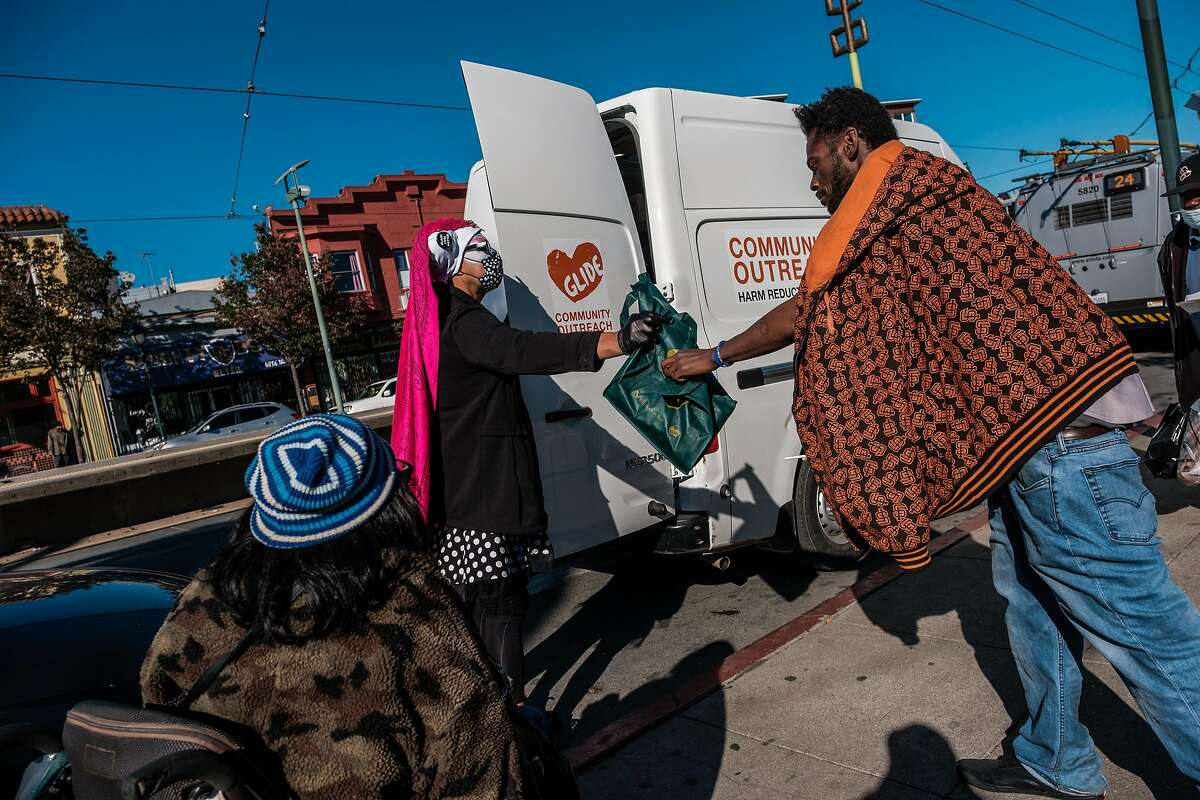 Sister Anya Streets delivers Thanksgiving meals provided by Glide in San Francisco.