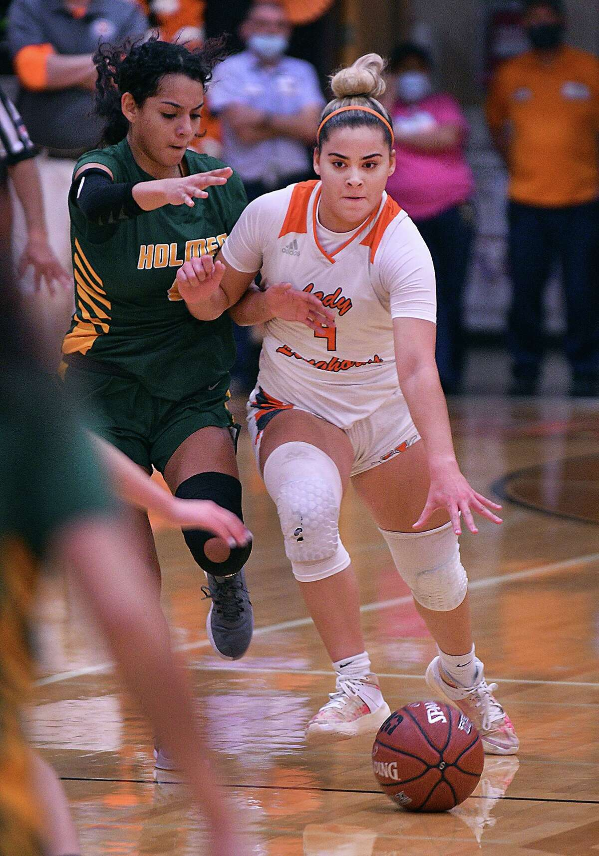 Evelyn Quiroz drives to the basket Wednesday in United's 71-58 win over San Antonio Holmes. Quiroz had a double-double with a season-high 25 points and 10 assists.