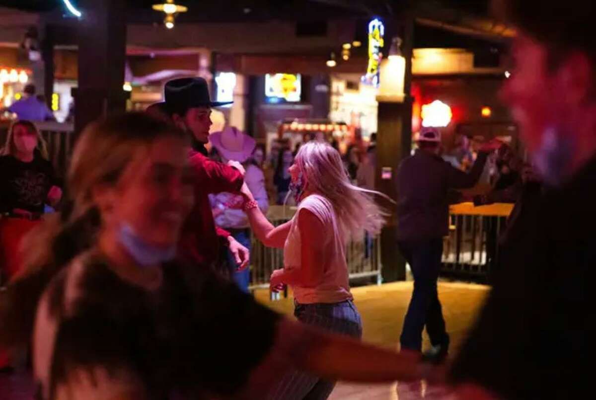 Guests dance at Billy Bob's Texas, a honky-tonk in Fort Worth.