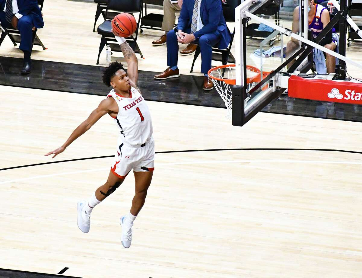 Texas Tech's Terrence Shannon, Jr. skies for the slam dunk during a non-conference men's college basketball game against Northwestern State on Nov. 25, 2020 in United Supermarkets Arena in Lubbock.