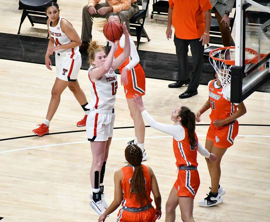 Texas Tech's Vivian Gray sinks a jumper over a trio of UTRGV defenders during their non-conference women's college basketball game on Nov. 25, 2020 in United Supermarkets Arena in Lubbock. Photo: Nathan Giese/Planview Herald
