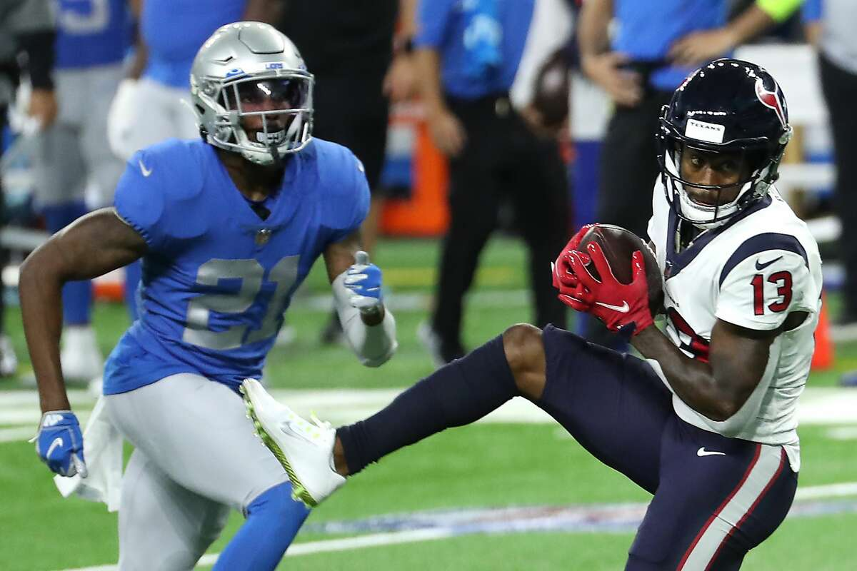 Houston Texans wide receiver Brandin Cooks (13) beats Detroit Lions defensive back Tracy Walker (21) for a first down reception during the second quarter of an NFL football game at Ford Field Thursday, Nov. 26, 2020, in Detroit.