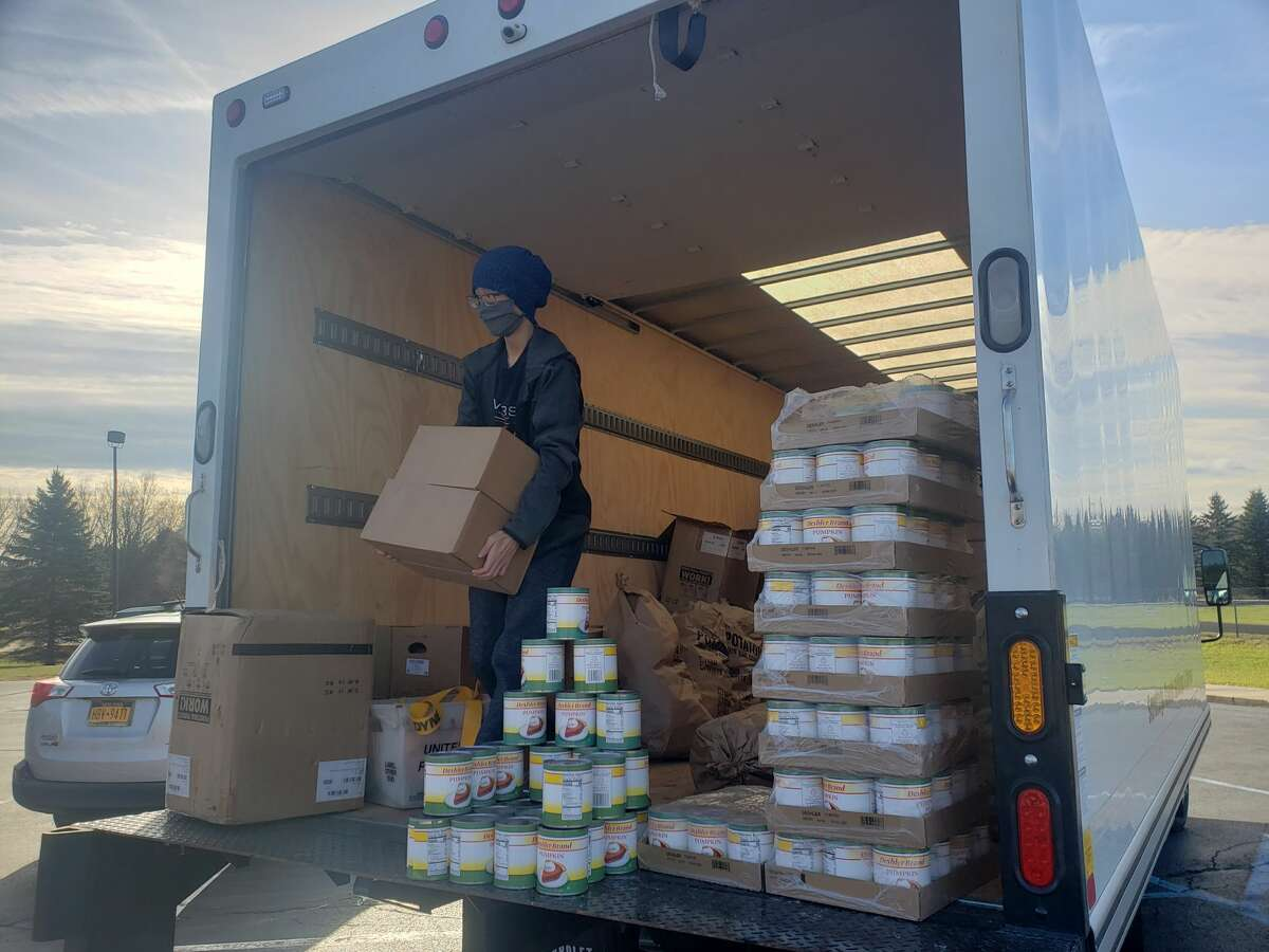 Saratoga County EOC Deputy Director Krystle Nowhitney Hernandez unloads Thanksgiving baskets at the Presbyterian-New England Congregational Church in Saratoga Springs on Thursday, Nov. 19, 2020. (Provided by Saratoga County EOC)