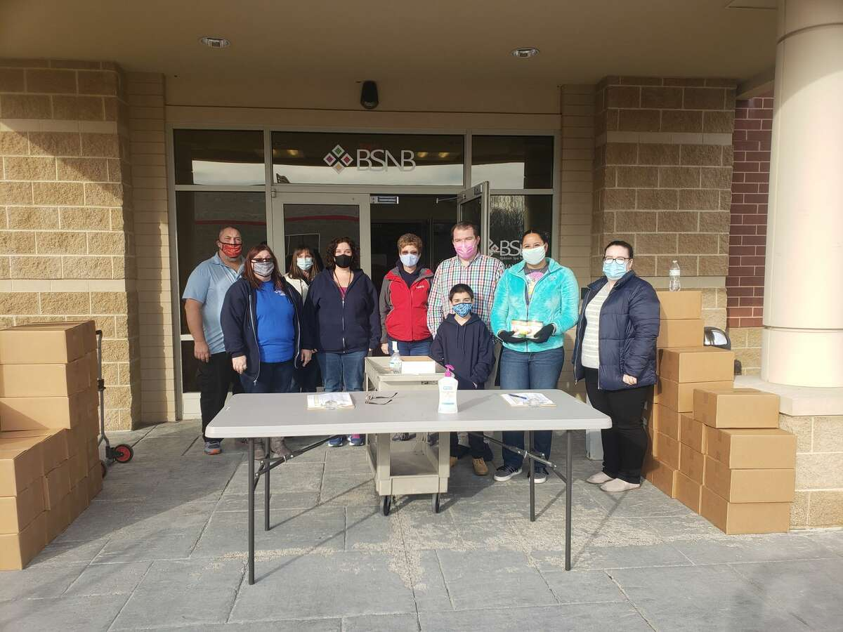 Ballston Spa National Bank volunteers were part of a team working throughout the county to distribute EOC's Thanksgiving baskets. (Provided by Saratoga County EOC)