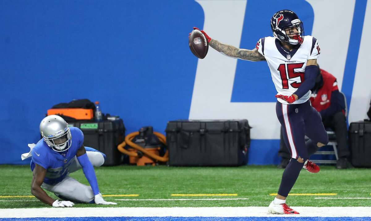 Houston Texans wide receiver Will Fuller (15) beats Detroit Lions cornerback Justin Coleman (27) for a 34-yard touchdown reception during the fourth quarter of an NFL football game at Ford Field Thursday, Nov. 26, 2020, in Detroit.