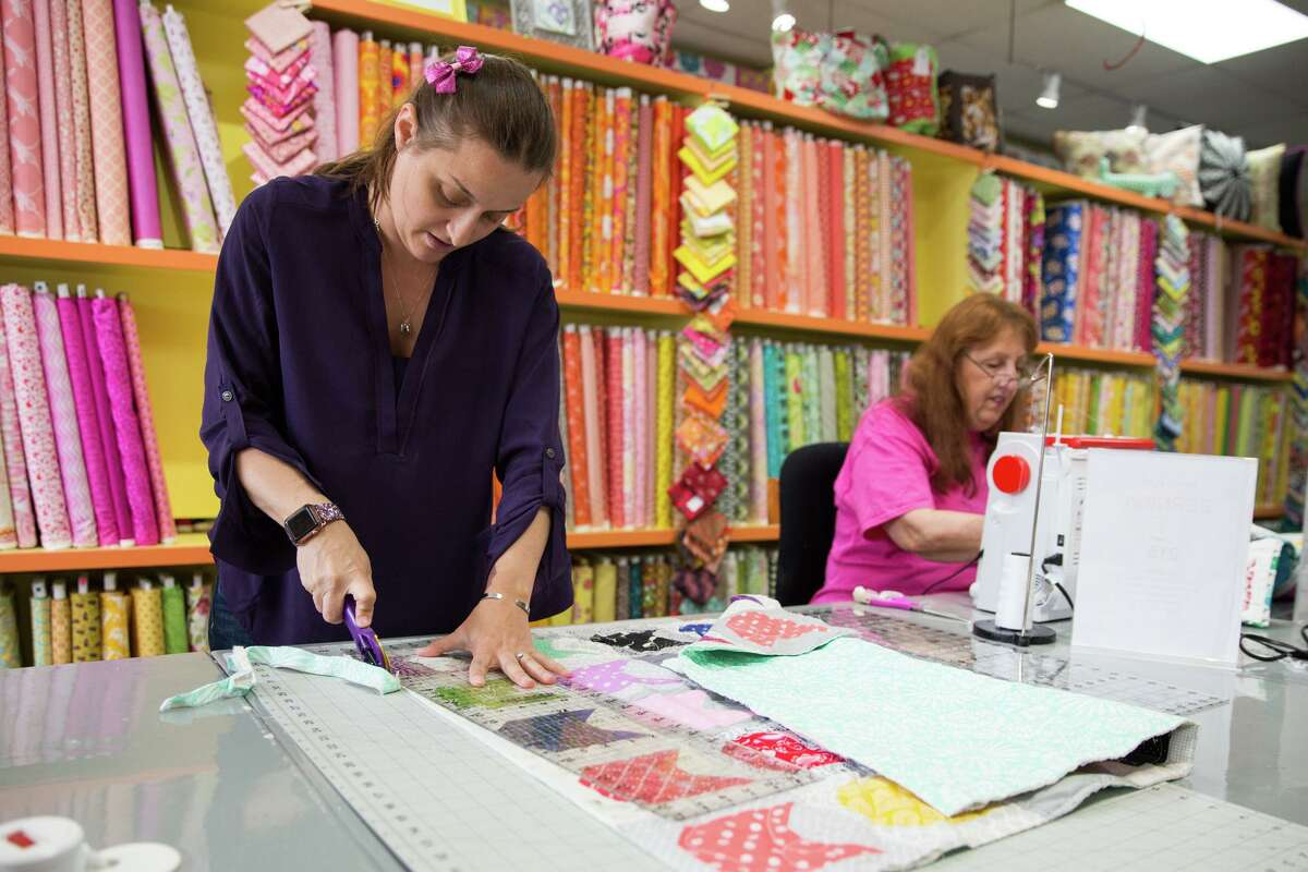 Christie Pugh and her mother-in-law Sydney Splan sew together quilts at Christie's Quilting Boutique in Norwalk, Conn. on Saturday, May 5, 2018.