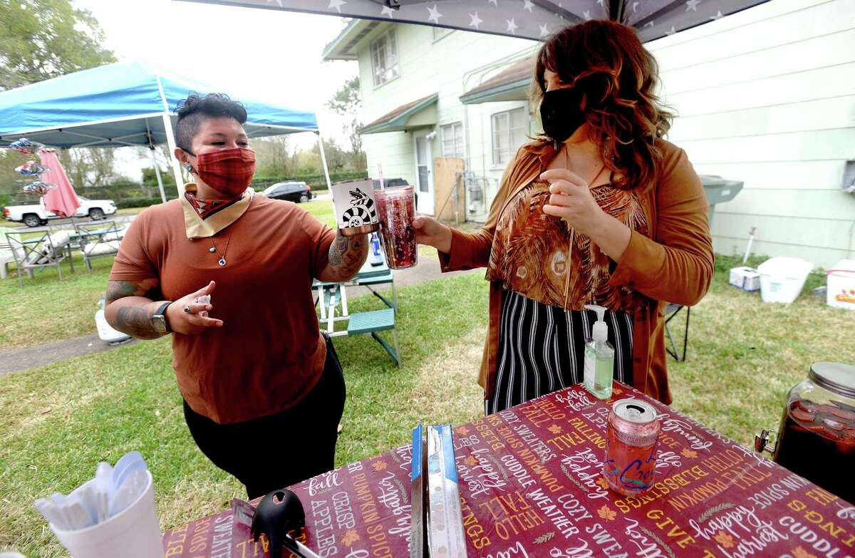 Neighbors Reyann Gonzales (left) and Grace Mathis toast as they and friends hold a socially distanced backyard picnic to safely celebrate Thanksgiving in the joint backyard of their Old Town residences. Photo taken Thursday, November 26, 2020 Kim Brent/The Enterprise