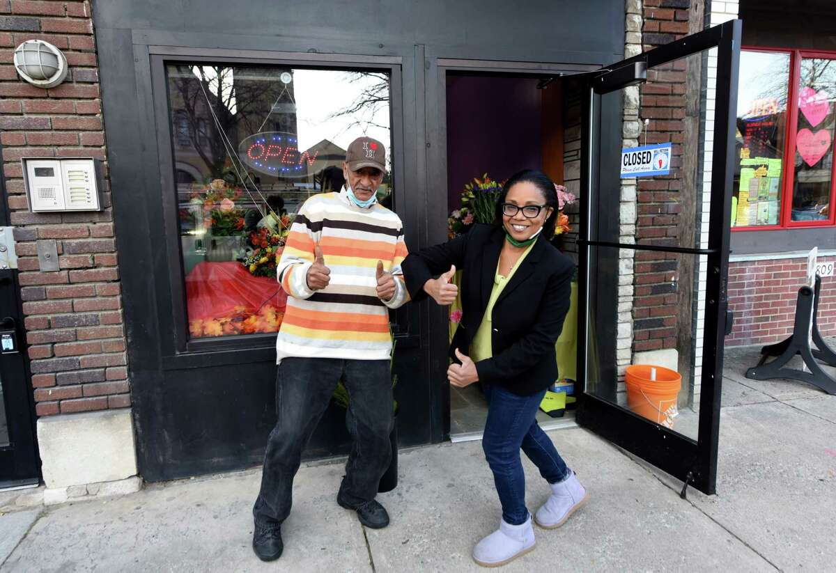 Blooms By Marie designer Phil Copeland, left, and owner Marie Campbell, right, are pictured outside the small Madison Avenue flower shop on Friday, Nov. 20, 2020, on in Albany, N.Y. Marie's small business has seen unexpected success this year. (Will Waldron/Times Union)