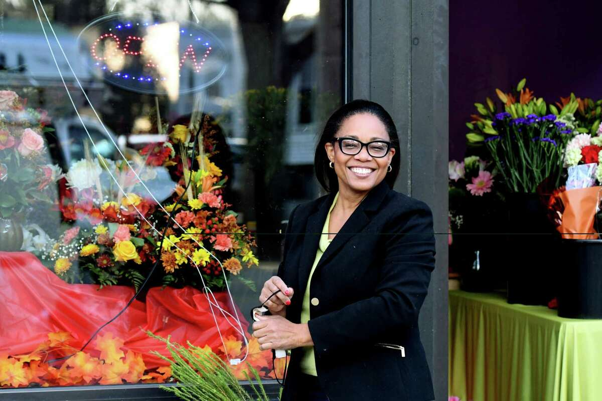 Marie Campbell is pictured outside of her flower shop, Blooms By Marie, on Friday, Nov. 20, 2020, on Madison Avenue in Albany, N.Y. Marie's small business has seen unexpected success this year. (Will Waldron/Times Union)