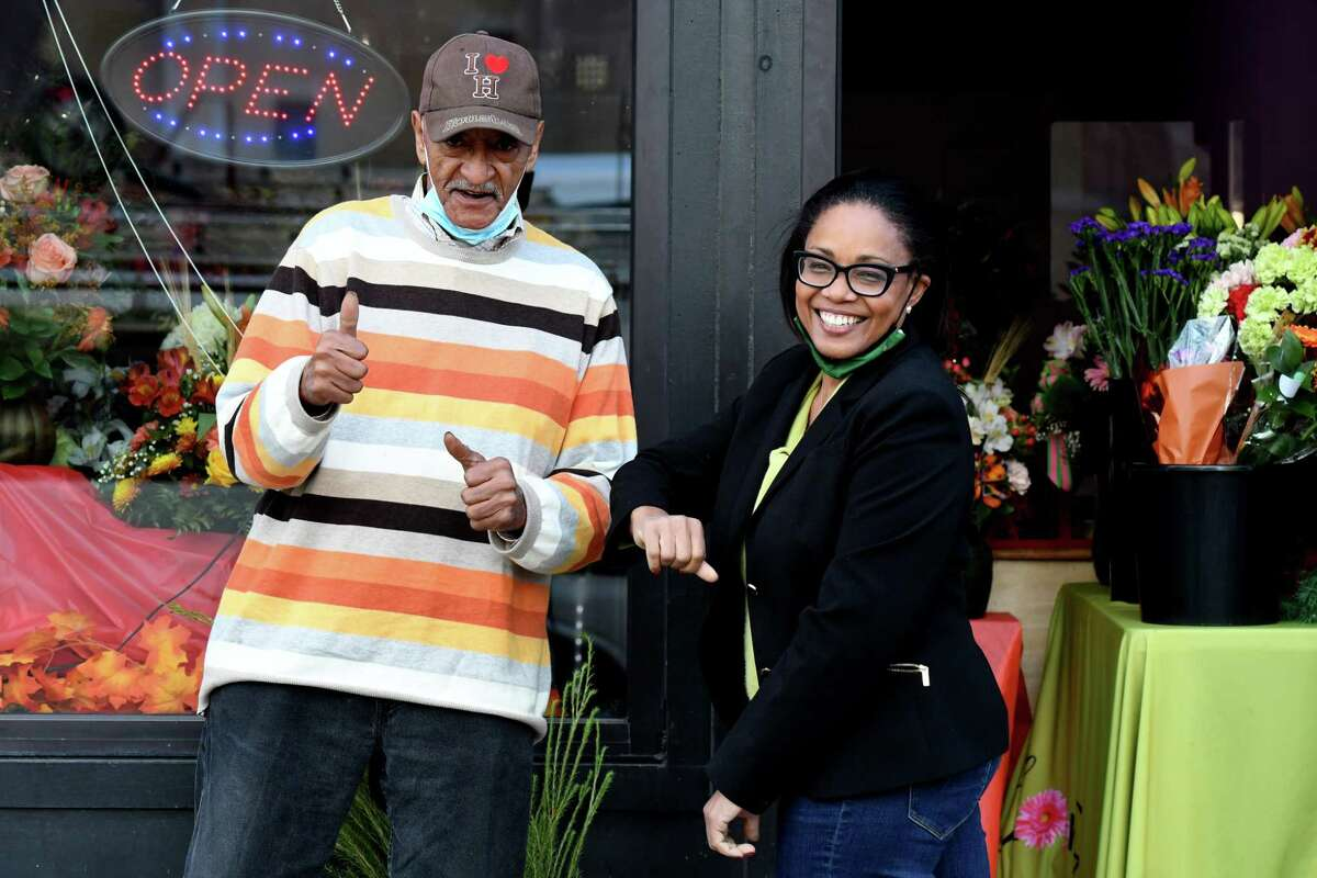 Blooms By Marie designer Phil Copeland, left, and owner Marie Campbell, right, are pictured outside the Madison Avenue flower shop on Friday, Nov. 20, 2020, on in Albany, N.Y. Marie's small business has seen unexpected success this year. (Will Waldron/Times Union)