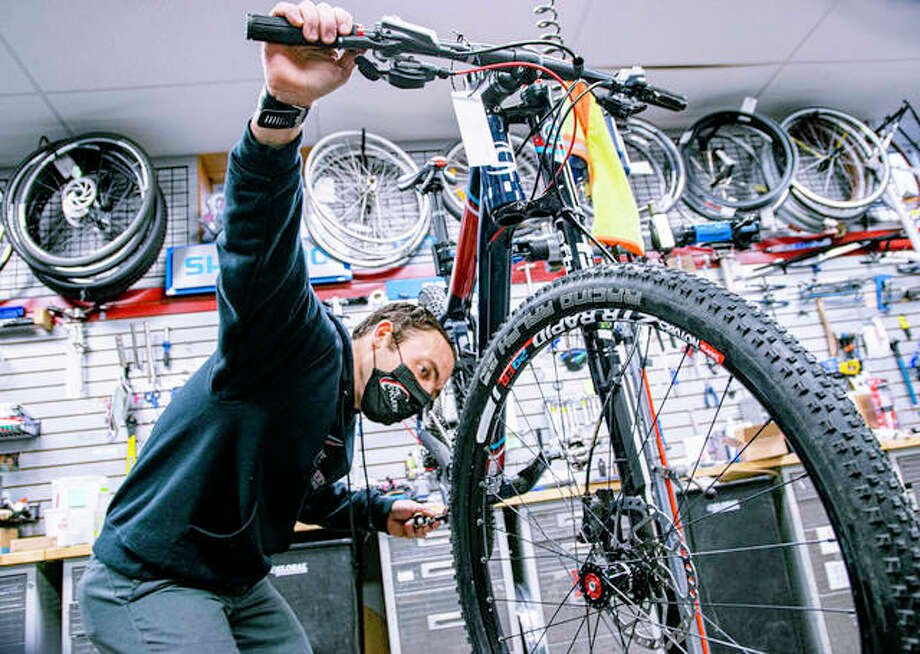 Bike mechanic Justin Allen makes final adjustments on a bike Tuesday afternoon at The Cyclery in Edwardsville. Photo: Tyler Pletsch | Intelligencer
