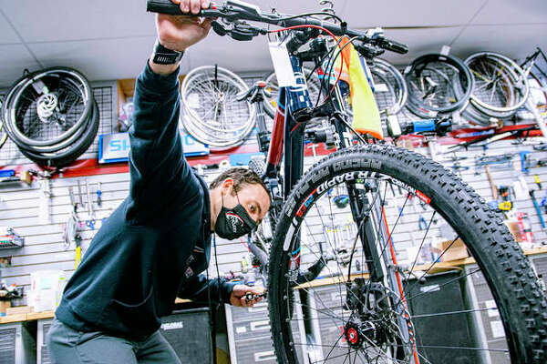 Bike mechanic Justin Allen makes final adjustments on a bike Tuesday afternoon at The Cyclery in Edwardsville.