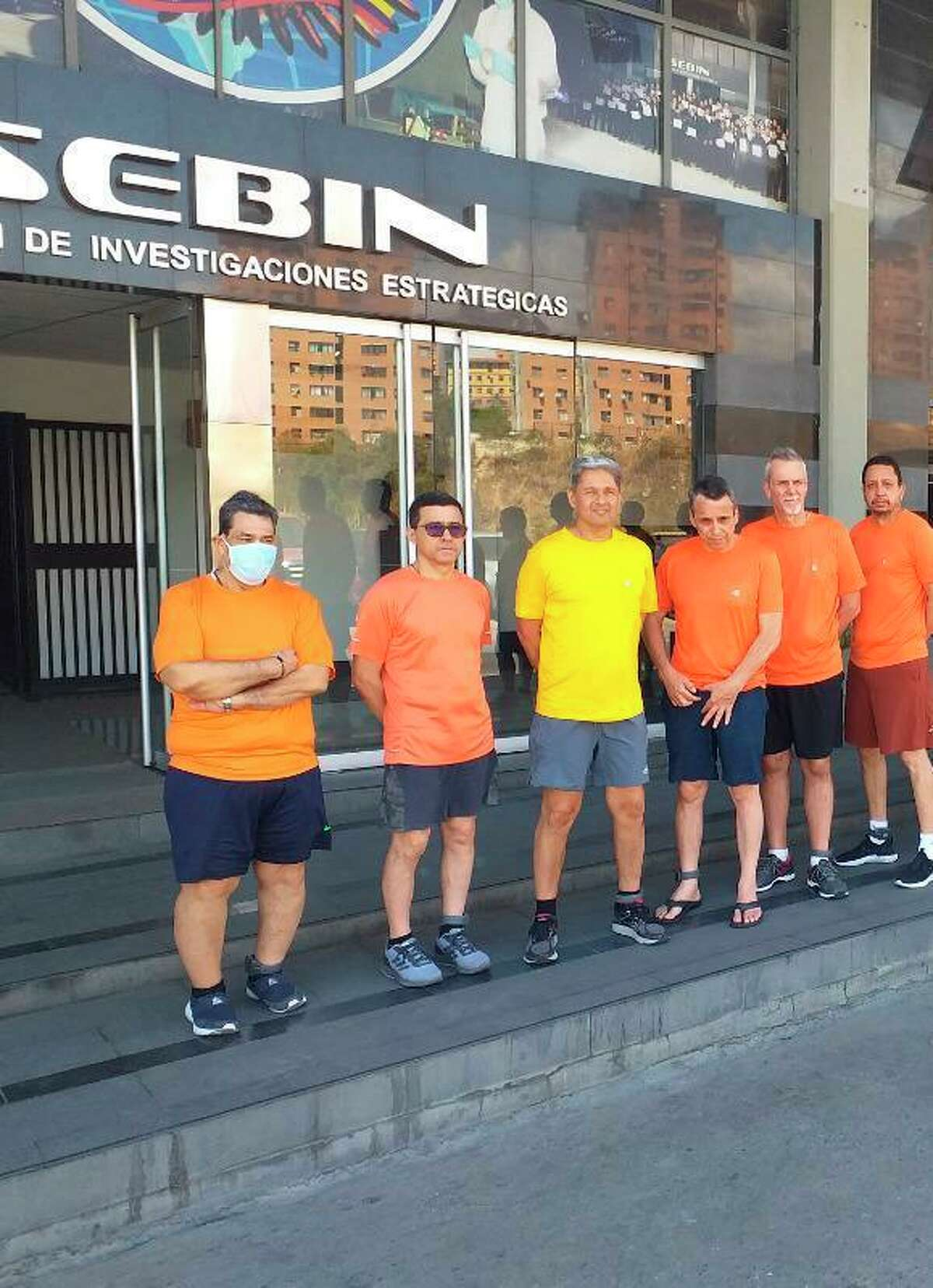 This undated file photo posted on Twitter on June 18, 2020 by Venezuela's Foreign Minister Jorge Arreaza, shows Citgo executives Jose Angel Pereira, from left to right, Gustavo Cardenas, Jorge Toledo, Jose Luis Zambrano, Tomeu Vadell and Alirio Jose Zambrano, standing outside the Bolivarian National Intelligence Service, in Caracas, Venezuela. The six executives held for three years in Venezuela were found guilty of corruption charges by a judge Thursday and immediately sentenced to prison, according to defense lawyers.