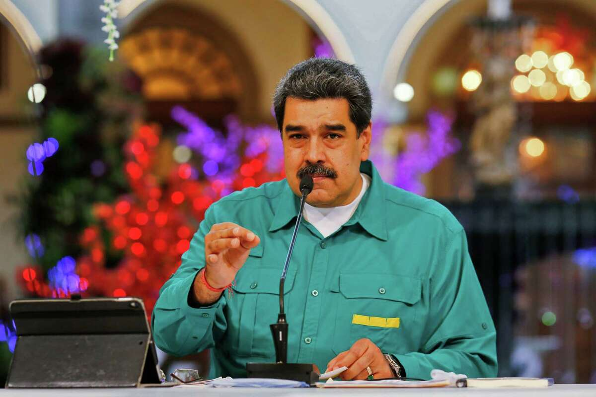 Handout picture released by the Venezuelan Presidency showing Venezuela's President Nicolas Maduro speaking November 15. Six Citgo executives held for three years in Venezuela were found guilty of corruption charges by a judge Thursday and immediately sentenced to prison