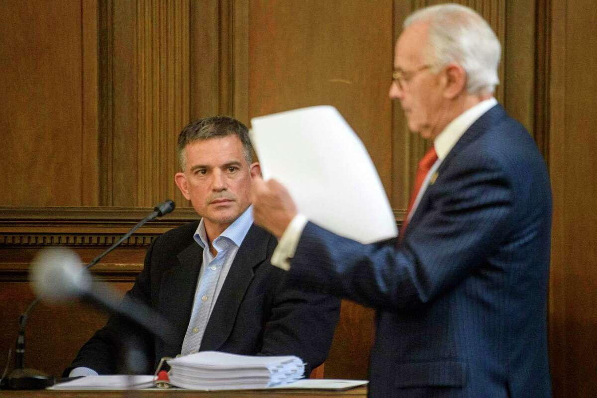 Fotis Dulos, left, is questioned by attorney Richard Weinstein, representing the estate of Hilliard Farber, during testimony in a civil case in Hartford Superior Court during his testimony in a civil case Wednesday, Dec. 4, 2019, in Hartford, Conn.