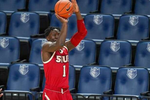 SIUE's Mike Adewunmi puts up a shot against LSU in front of empty seats inside Chafietz Arena on Thursday in St. Louis.