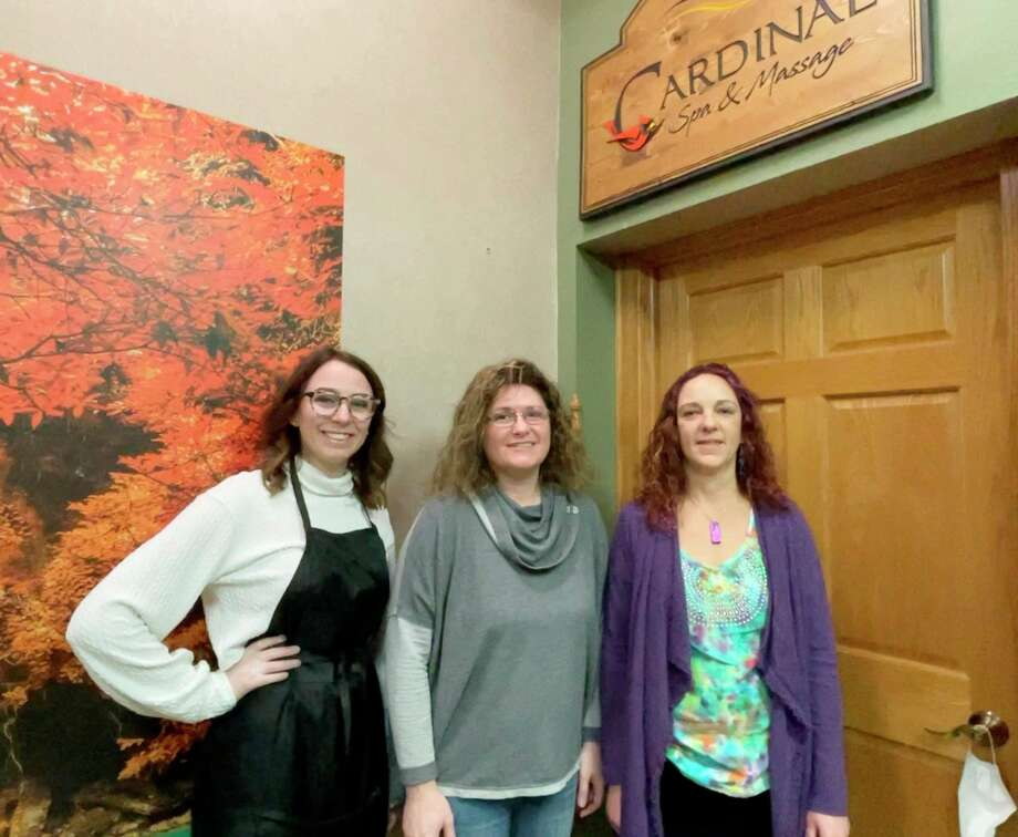 (From left) Anna Thompson, Monica Schriner, and Laurel Humphreys take a break during a busy shift at Cardinal Spa and Massage to share a smile with the camera. Cardinal Spa and Massage is located at 126 Maple St., Suite C, in Big Rapids. (Pioneer photo/Bradley Massman)