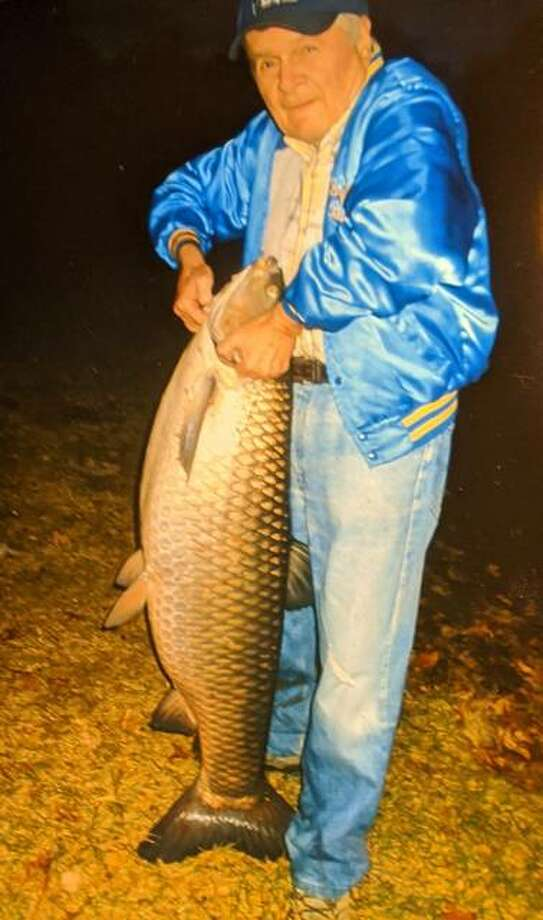 Buddy Wolke, retired math teacher from Alton High School, recently caught this grass carp at Gilmore Lake near Columbia, Illinois. The fish was 50 inches long, with a girth of 34 inches, and weighed 60 pounds. The fish was caught with a light action reel and 6-lb. test line using a white hair jig tipped with a nightcrawler. It took Wolke almost 30 minutes to land.