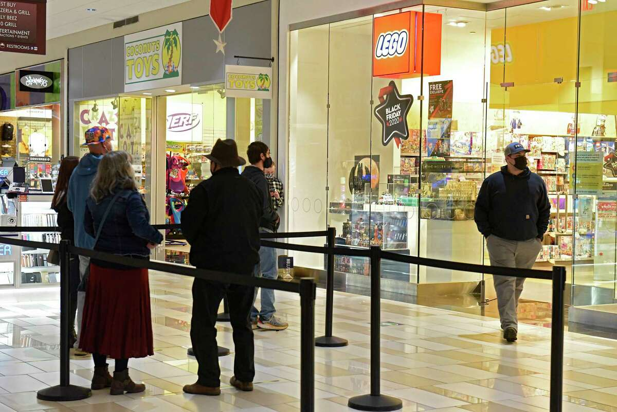 Black Friday holiday shoppers wait in a line at the Lego store at Crossgates Mall on Friday, Nov. 27, 2020 in Guilderland, N.Y. Due to the pandemic, stores were limiting the number of people allowed in the stores. (Lori Van Buren/Times Union)