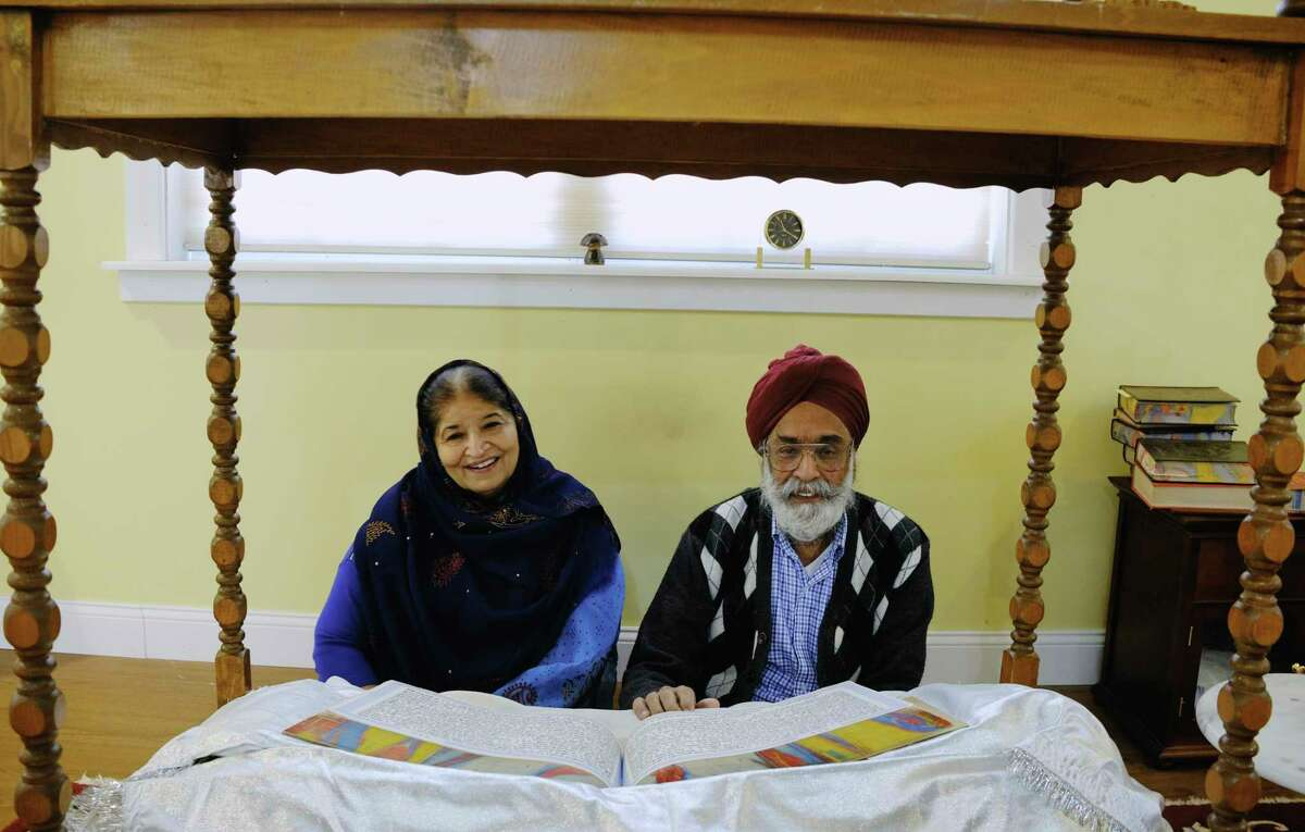 Neelam Narang, left, and her husband, Rajinder Narang, poses for a photo in the prayer room at their home on Thursday, Nov. 19, 2020, in Clarksville, N.Y. (Paul Buckowski/Times Union)