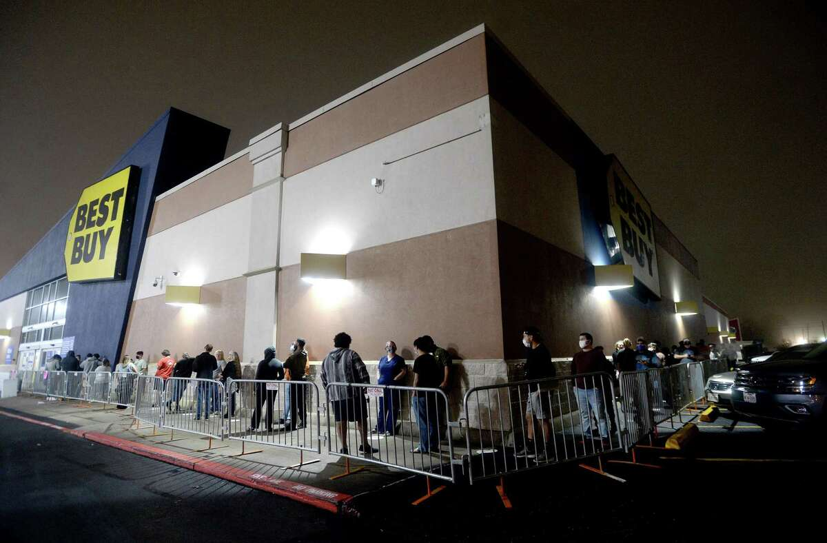 A line spreads around the corner in the final minutes before doors opened at Best Buy on Black Friday. Photo taken Friday, November 27, 2020 Kim Brent/The Enterprise
