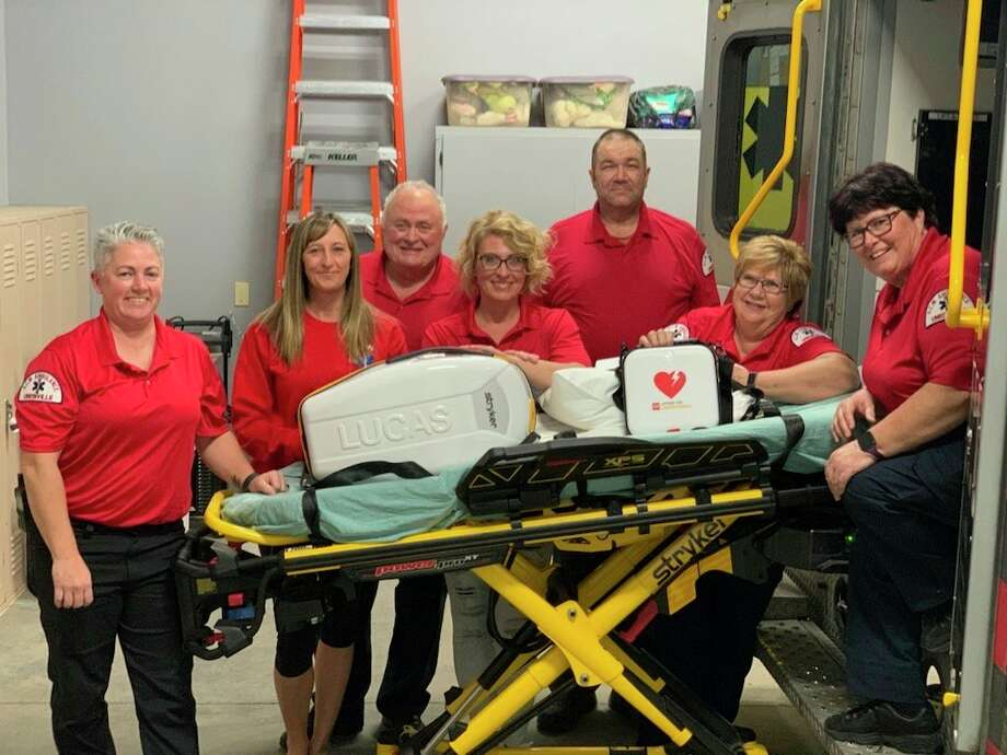 Pictured from left to right are Denise Maguire, driver; Tara Winter, EMT; Lonnie Vermeersch, MFR; Rebecca Fritz, EMT; Kenneth Currey, EMT; Kathy Hare, EMT; and Alice Vermeersch, EMT. The new equipment includesbariatric side rails and mattress, new Lucas chest compression machine, new defibrillator, and updated auto-load cot. (Courtesy Photo)