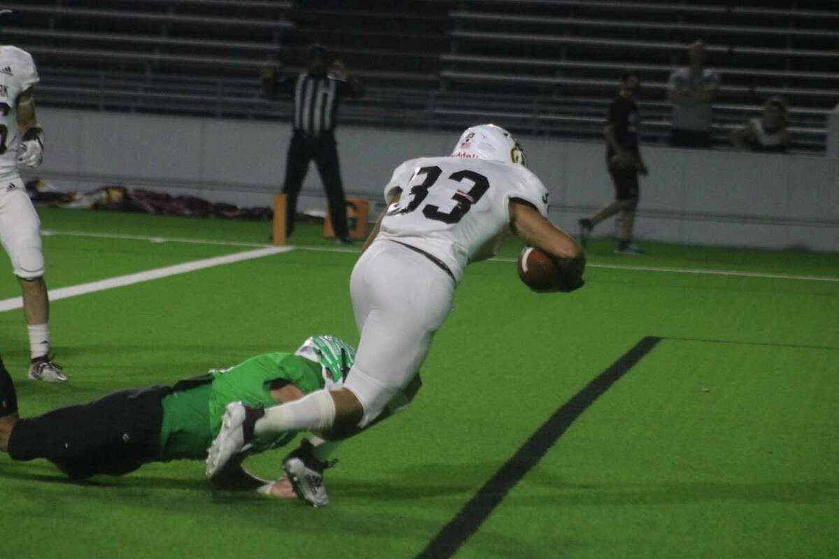 Deer Park sophomore Erasmo Canales, who tries to elude the tackle of a Pasadena Eagle, will take part in the 43rd meeting with South Houston in a 2 p.m. kickoff Friday afternoon.
