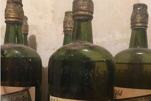 Nick Drummond and Patrick Bakker bought a fixer-upper in Ames, N.Y. and found 88 bottles of Prohibition-era whisky in the walls and under the floorboards.
