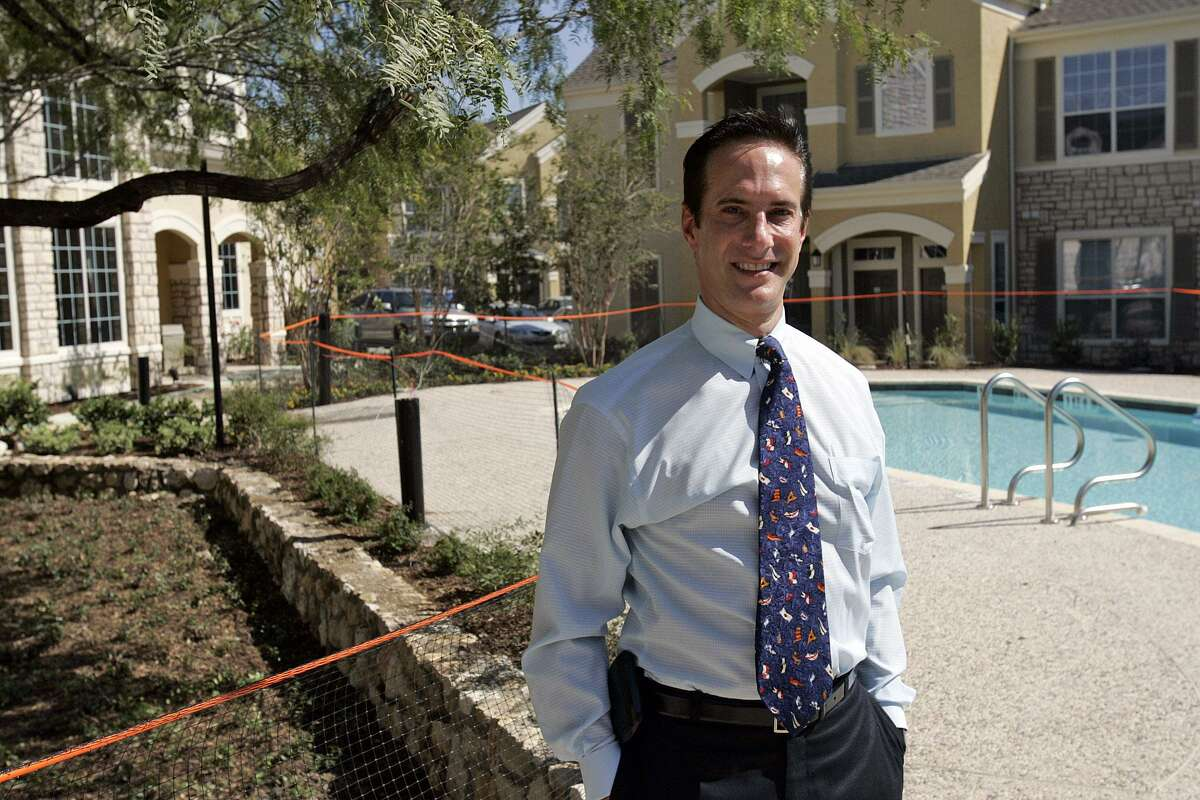Developer Dan Markson poses Wednesday, October 19, 2005 in the pool area of Costa Biscaya, a 250 apartment community at 5100 Eisenhauer Road that will opening this weekend. (TOBY JORRIN/SPECIAL TO EXPRESS-NEWS)