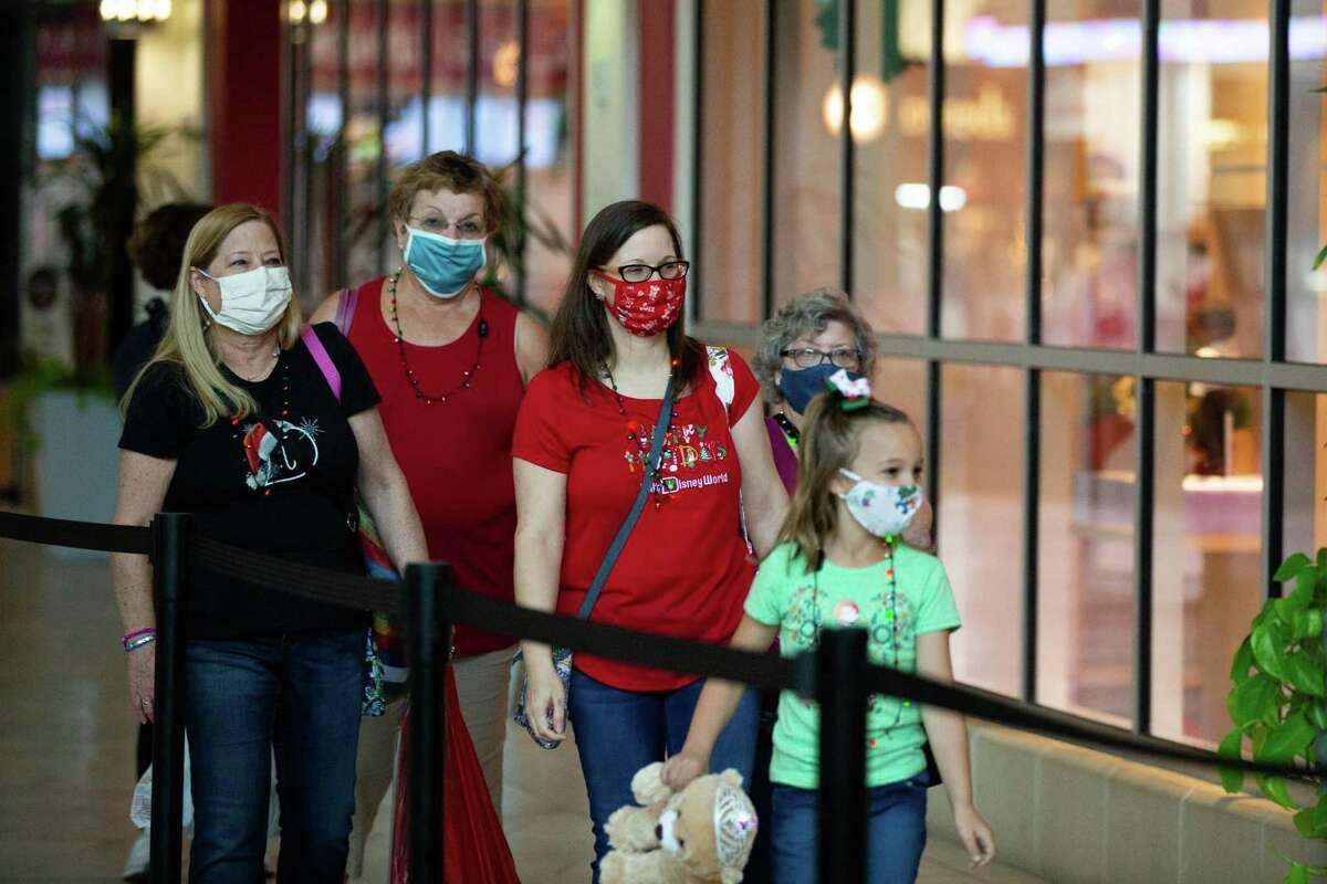 Darleen Moreau, Patricia Schaefer, Michelle Schaefer, Betty Laizer, and Juliet Schaefer, 8, wait to enter American Girl on Black Friday, Friday, Nov. 27, 2020, in Houston.