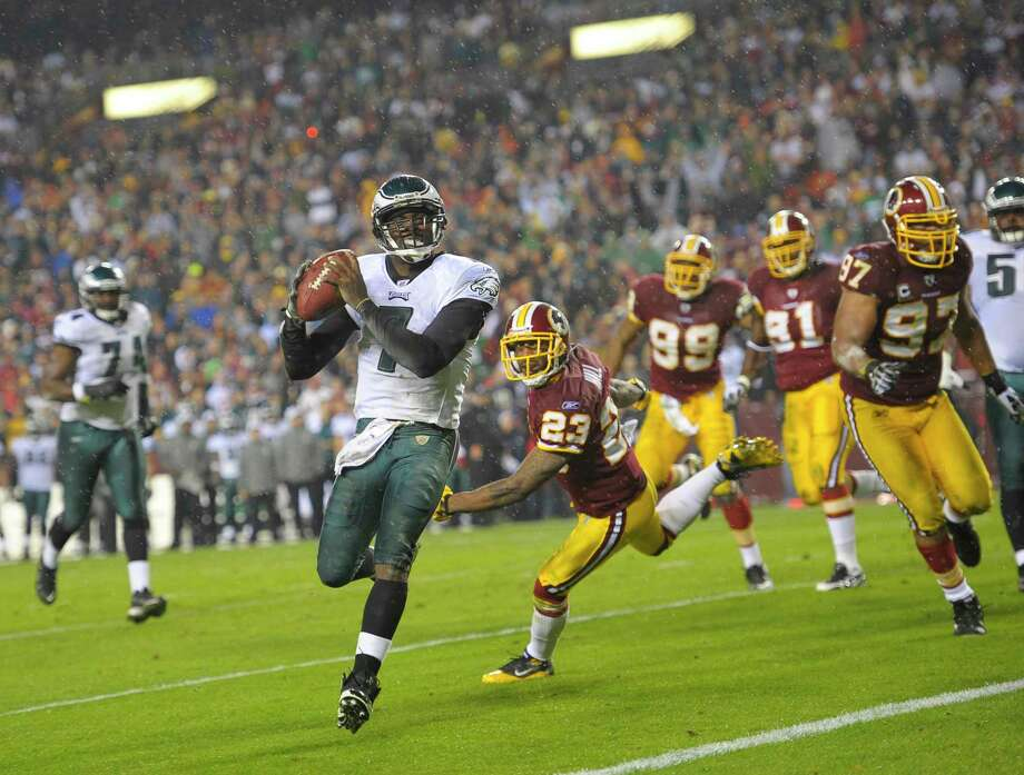 Philadelphia Eagles quarterback Michael Vick runs for a touchdown in 2010 during a game against Washington's football team at FedEx Field in Landover, Md. Photo: Washington Post Photo By John McDonnell / The Washington Post