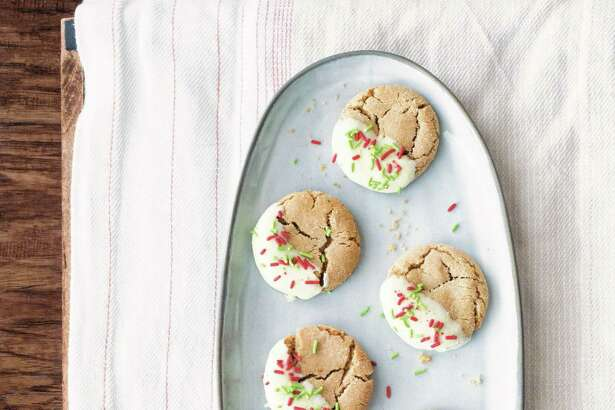 White Chocolate-Dipped Ginger Crinkles (recipe in column): These pretty Christmas treats are dipped in white chocolate and sprinkled with red and green sprinkles - like they're all wrapped up for Christmas.