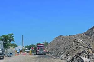 The town has filed suit against Julian Development for its failure to reduce the fill pile at One Rod Highway, and for accepting some contaminated materials. Fairfield,CT. 5/10/17