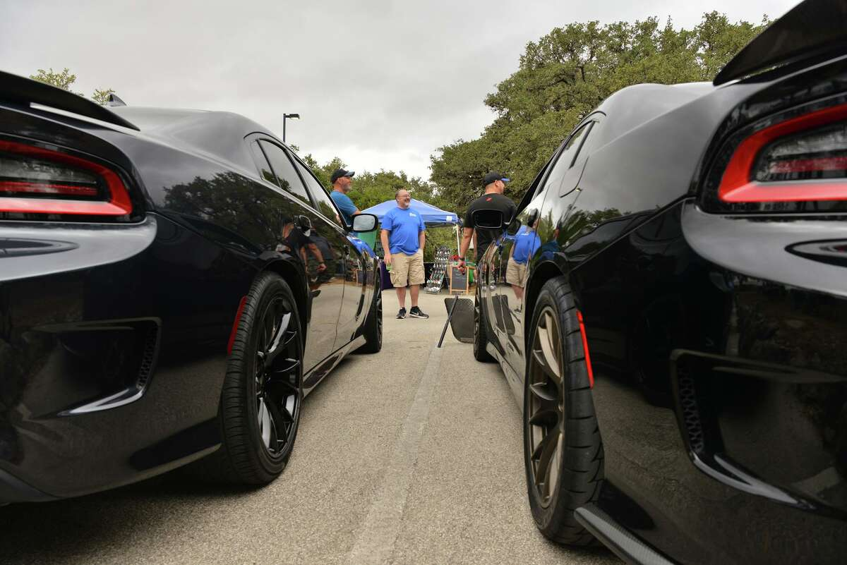 Paul Lobre chats with other car enthusiasts Cars at a 'cruise in' by the Alamo City LX Modern Mopar, a car club, on a recent Saturday morning at 247 Church on the North Side. Older car meet aficionados are irritated by a more reckless and confrontational culture they say social media has encouraged among younger drivers.