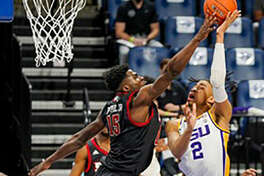 SIUE's Philip Pepple Jr. goes up to block a shot by LSU's Trendon Watford on Thursday night in the Billiken Classic at Chaifetz Arena in St. Louis. Pepple had a double-double in the Cougars' loss.