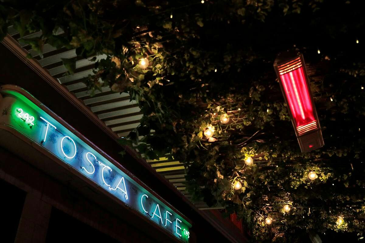 Infrared heaters keep diners warm in the outside dining area at Tosca Cafe where dinner service has resumed in San Francisco, Calif., on Wednesday, November 18, 2020. Tosca has reopened for outdoor dining with an elaborate parklet.