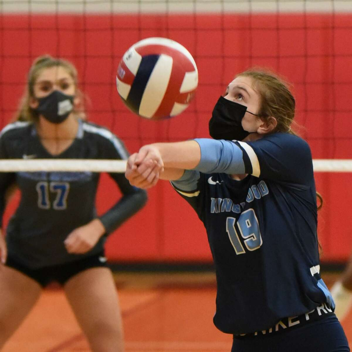 Kingwood setter Sydney Hicks setting up an outside hitter in a Class 6A match against Clear Springs.