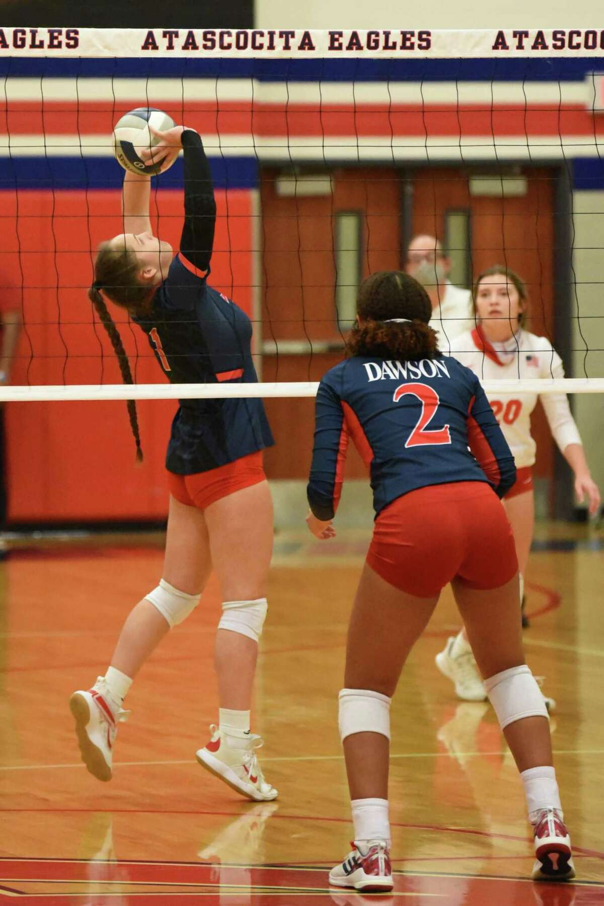 Atascocita setter Trinitiy Funderburk sets up her outside hitter for a kill during a Class 6A area round match against Pearland Dawson.
