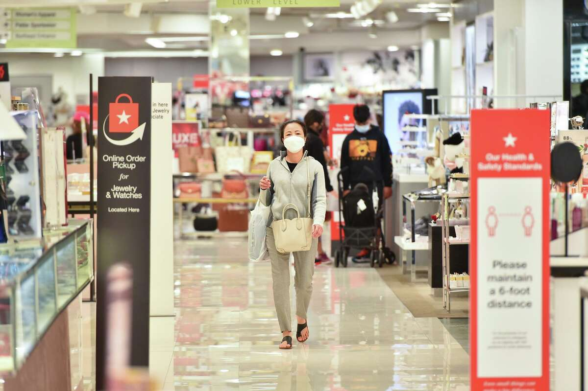A woman walks through Macy's at North Star Mall during early Black Friday shopping.