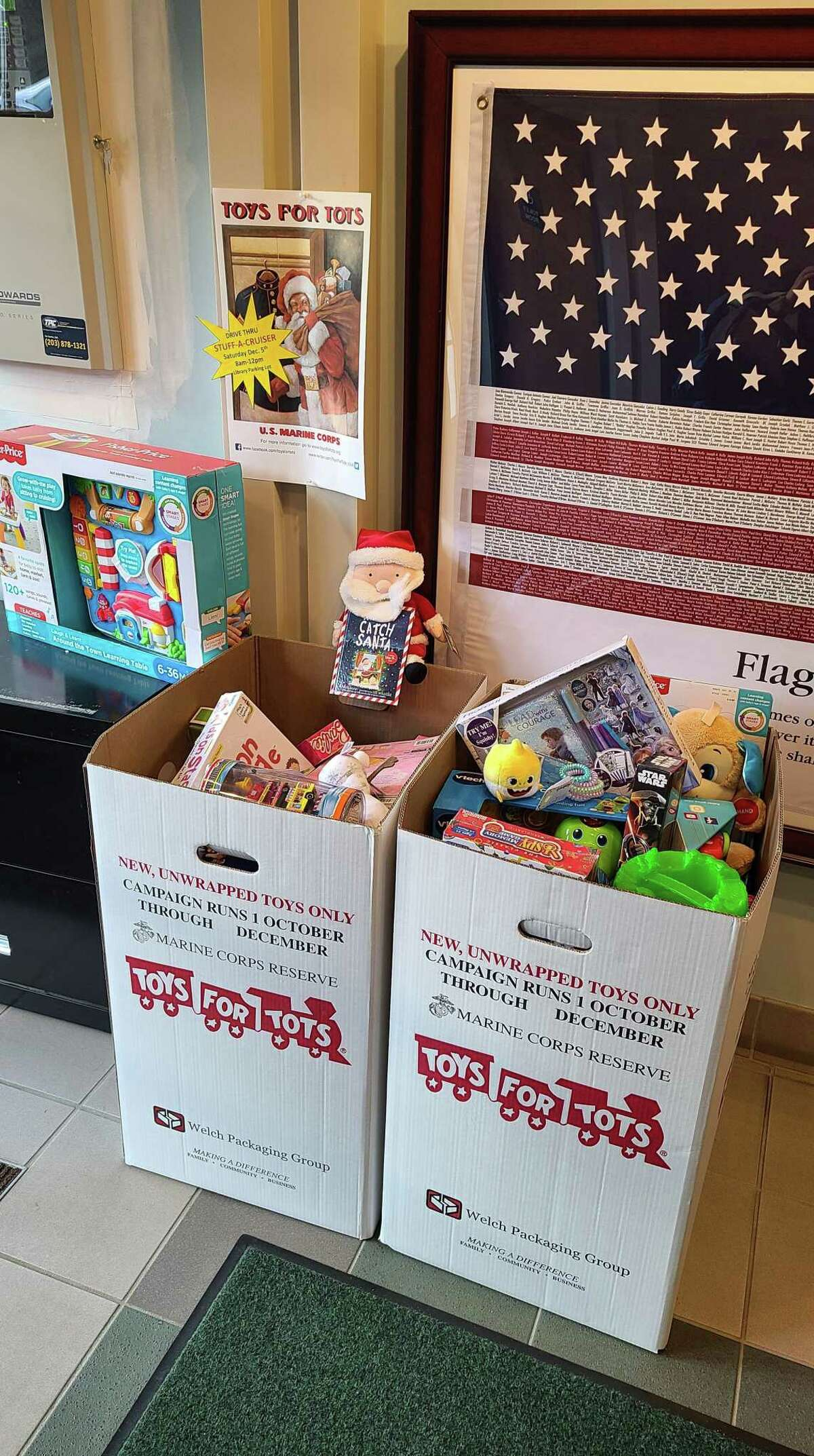Donation boxes in Easton Police Department lobby for stuff-a-cruiser event.