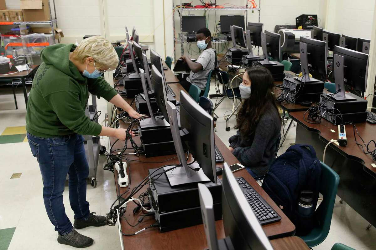 Cybersecurity teacher Abby Suneson, left, works with freshman Mariana Font, 14, during class at Northside School of Innovation, Technology and Entrepreneurship on Nov. 13.