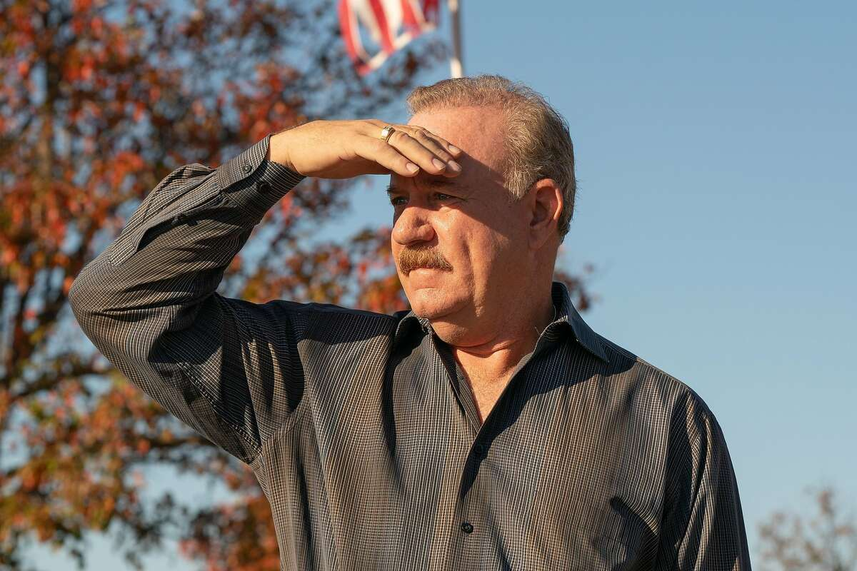 Chris O'Brien, 60, looks toward the cattle ranch on his property in Livermore, Calif., on Tuesday, Nov. 24, 2020. O'Brien is opposed to a 500-acre solar development plan, which will cover the open space surrounding his home in North Livermore.