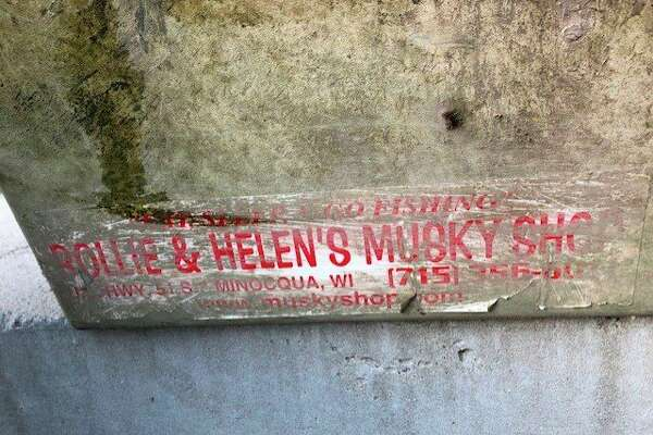 "This sticker on Ron Berry's tackle box, ""Rollie & Helen's Musky Shop"" -- identifying the Wisconsin store he ordered it from 17 years ago -- helped Mark Fales of Fisher Contracting track down Berry after the box was extracted from the debris at the Sanford Dam. (Photo provided/Dolores Porte)"